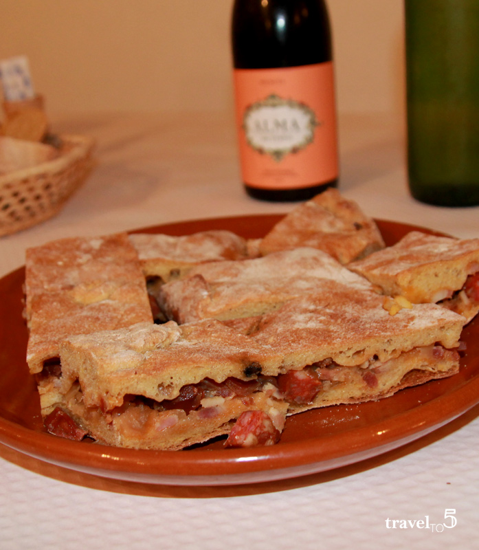 Traditional Galician empanada cooked on wood oven at Casa do Patron, Lalin Galicia Spain food - travelto5.com